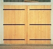 Portes de garage gedimat for Fabrication porte garage bois 2 vantaux